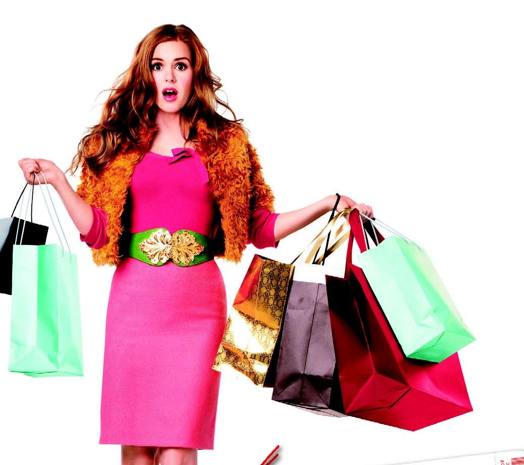 Shopping spree, woman wearing pink dress holding shopping bags