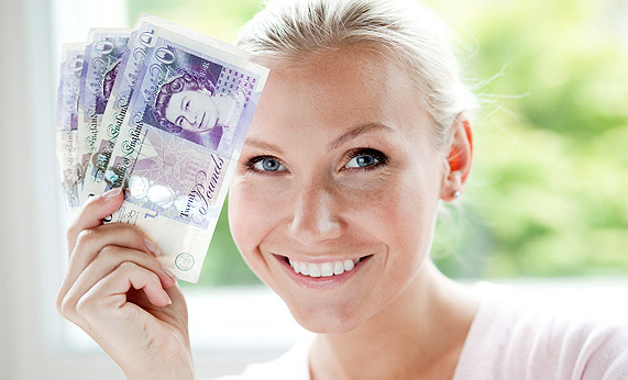 Woman holding money, blonde woman smiling holding money